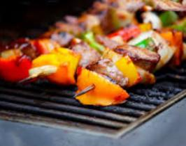 Sublime Lamb Kebabs cooking over Hot Charcoals.