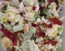 Caesar salad with large shavings of Grana Padano, oven dried prosciutto  and homemade Caesar dressing