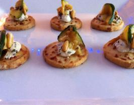 Gruyere biscuits topped with chargrilled courgette, marinated goats cheese and pinenuts